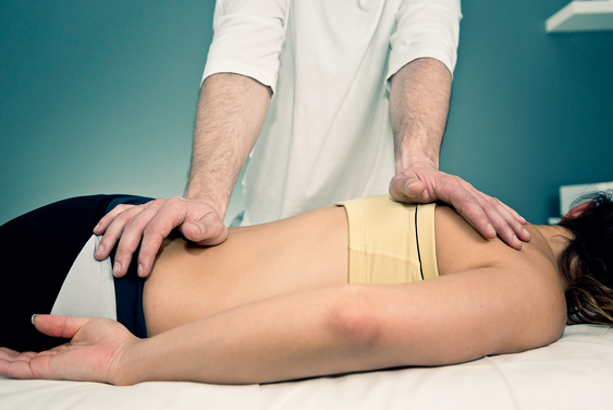 Chiropractor Adjusting Patient with Back Pain