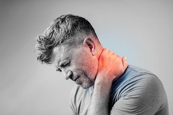 What are common symptoms of whiplash?