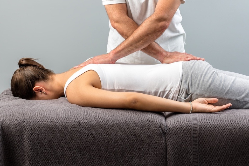 Chiropractor Adjusting Woman in Inverness, FL