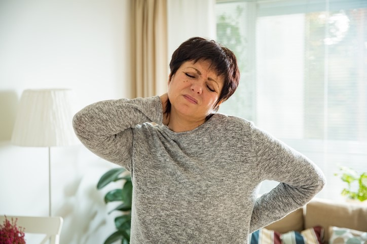 Woman Suffering from Severe Neck and Back Pain