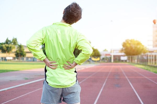 Pain in the lower back is often a symptom of a bulging disc