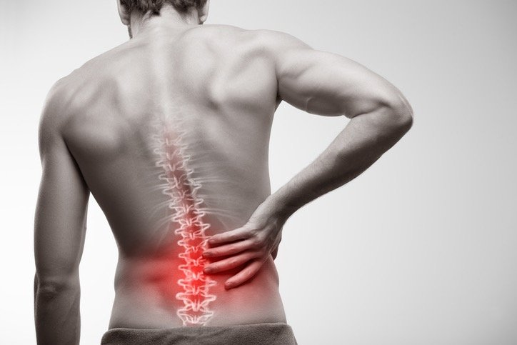 Low back pain inflammation with problem area highlighted
