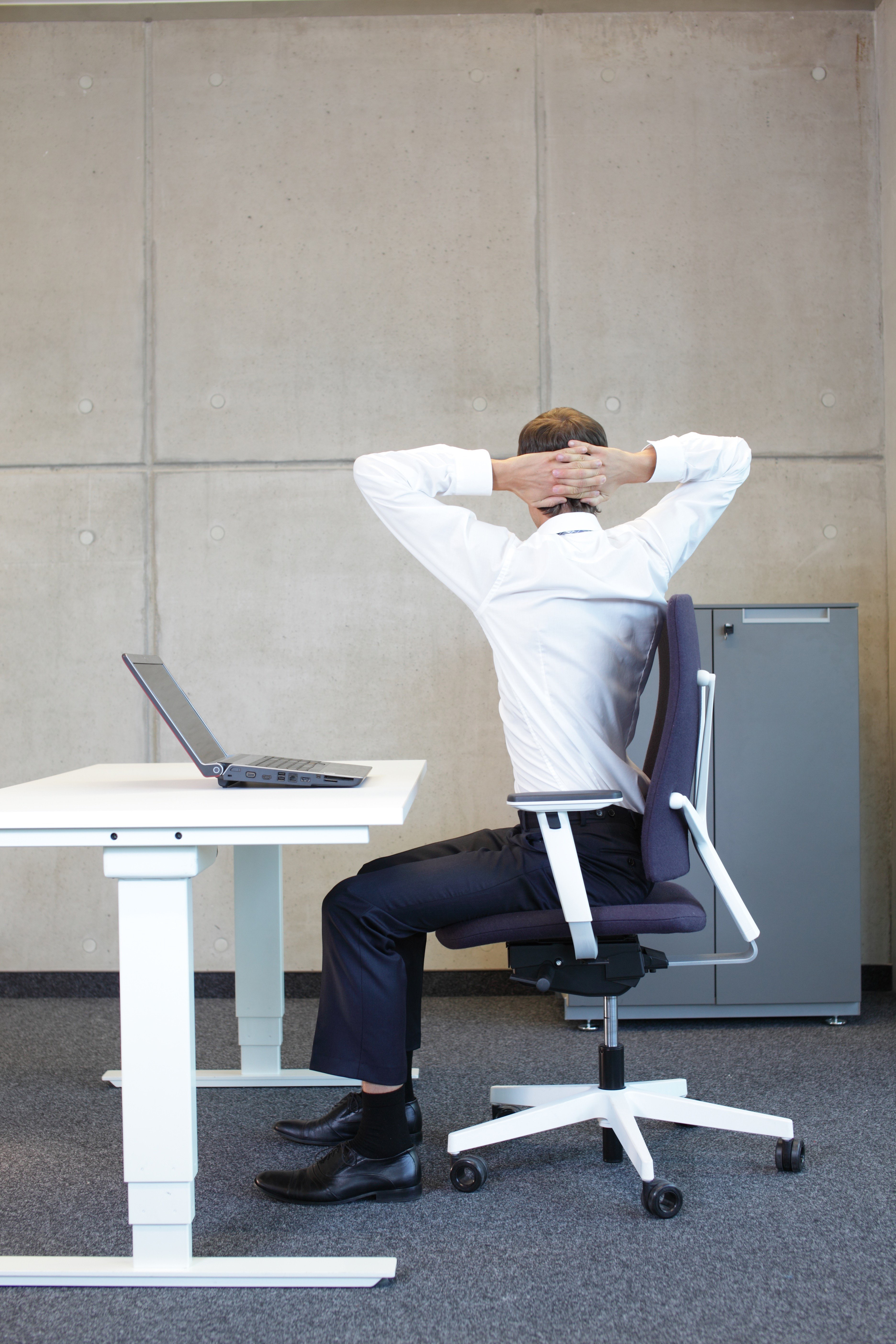 Man with Lower Back Pain from his Desk Chair